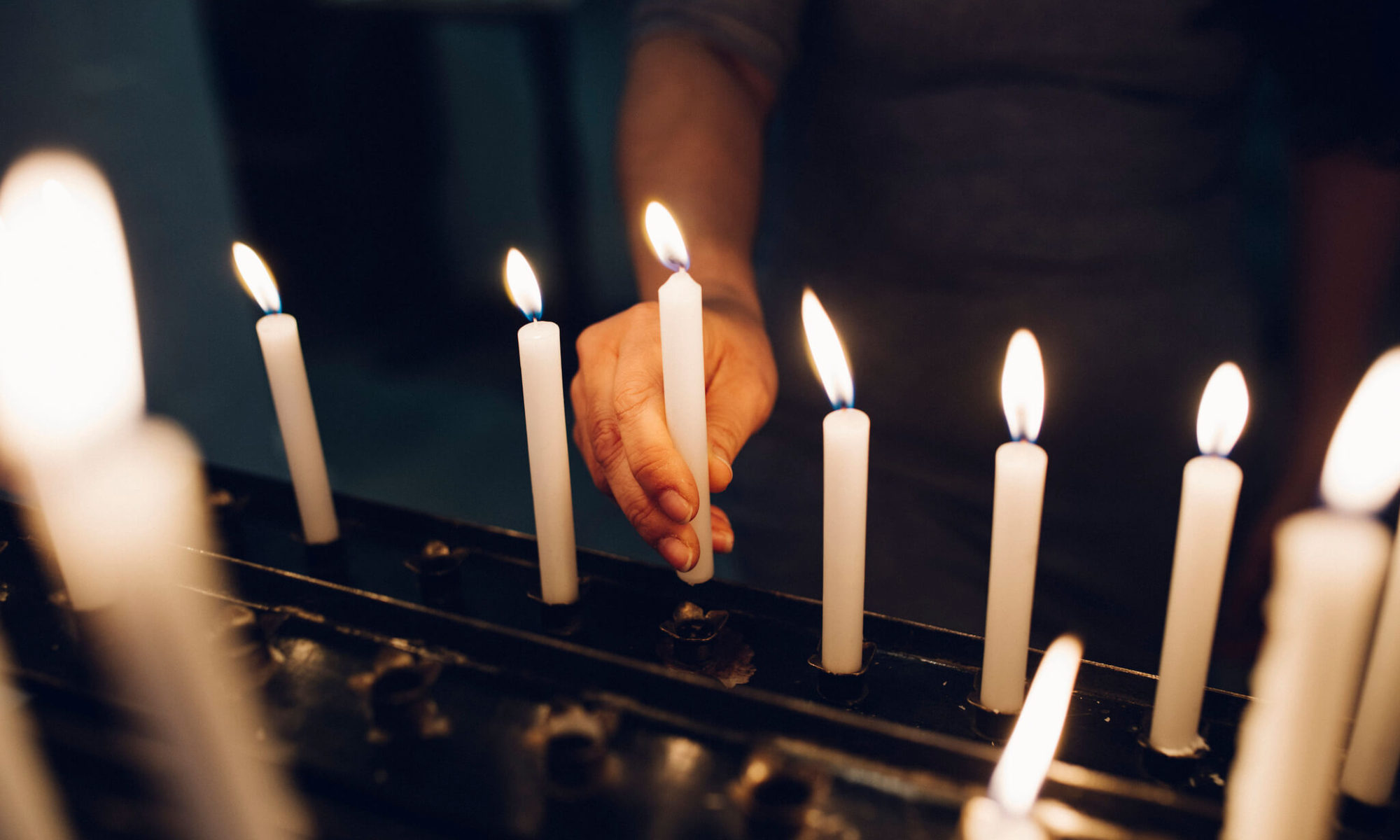 Praying with candle